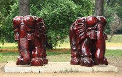 Two statues of elephants in park Stock Image