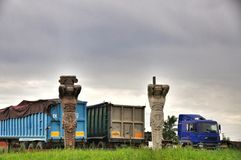Two statues and a truck Stock Images