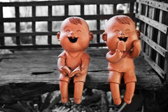 Two statuettes of funny boy and girl Royalty Free Stock Image