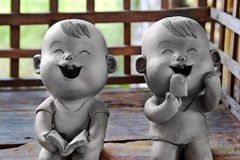 Two statuettes of funny boy and girl Stock Photography
