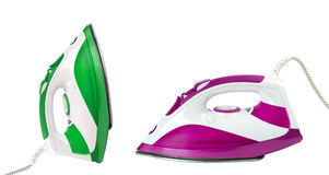 Two steam irons isolated on white background royalty free stock photography