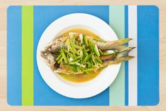 Two steamed mackerel fishes with ginger Royalty Free Stock Photo