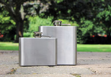 Two steel flasks outdoor Royalty Free Stock Image