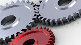 Two steel gears in connection with red one. Concept for teamwork and business Stock Photo