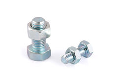 Two steel hexagon bolts and nuts isolated Stock Photos