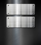 Two steel metal plates on black Royalty Free Stock Images