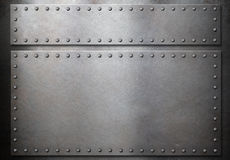Two steel plates with rivets over metal background. Two steel metal plates with rivets over grunge background royalty free stock photo