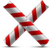 Two steel protecting road barrier by a letter X Royalty Free Stock Photos