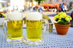 Two steins beer garden in the city Stock Photos