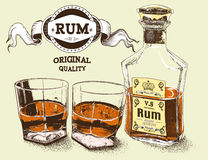 Two stemware of rum with bootle Stock Images