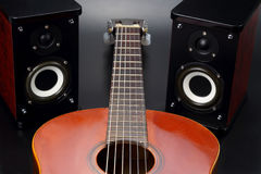Two stereo audio speakers, and classical acoustic guitar Stock Photo