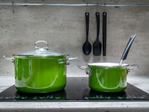 Two stewpots on induction cooker Stock Images