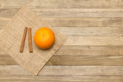 Two stick cinnamon and mandarin fruit on woode. N background Royalty Free Stock Photography