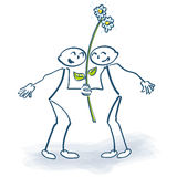 Two stick figures with a flower Stock Photo