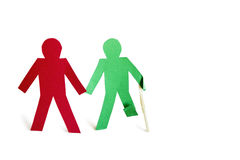 Two stick figures holding hands one with an injury over white background Stock Photo