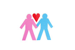Two stick figures holding hands with a red paper heart over white background Royalty Free Stock Image