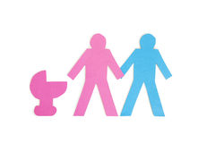 Two stick figures holding hands while standing besides a baby carriage over white background Royalty Free Stock Photography