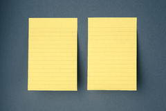 Two sticky papers on the wall Royalty Free Stock Images