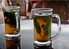 Two stimulating jugs of green tea. In Morocco Royalty Free Stock Photography