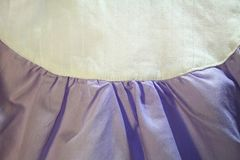 Two stitched fabrics of light purple and white with a place for Stock Images