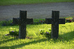Two stone crosses in a military cemetery Stock Photos
