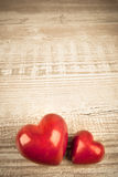 Two stone hearts on a wooden table Royalty Free Stock Image