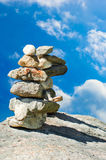 Two stone pyramids over blue sky Stock Images
