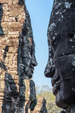 Two stone smiling faces of the Prasat Bayon Wat temple in the jungle, Angkor wat, Cambodia. Angkor Wat isthe largest Royalty Free Stock Photo
