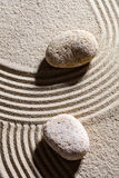Two stones across sand lines for concept of spirituality. Zen sand still-life - two stones set across sand lines for concept of spirituality or serenity, top Stock Photos