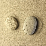 Two stones in the sand. Golden colors Stock Photo
