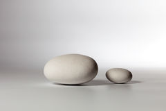 Two stones on white background Royalty Free Stock Image