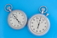Two stopwatch on blue Royalty Free Stock Photo