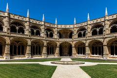 Two-storey cloisters of the Jeronimos Monastery. The monastery is one of the most prominent examples of the Portuguese Late Gothic Manueline style of Royalty Free Stock Photography