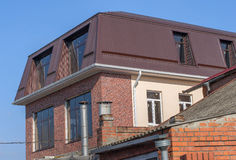 Two-storey extension to the house. A new two-storey extension to the house with a brown roof Stock Images