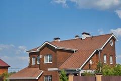 Two storey house with Bavarian laying bricks royalty free stock image