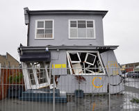 House Damaged By An Earthquake. A two storey house is destroyed by a 6.2 magnitude earthquake Stock Image