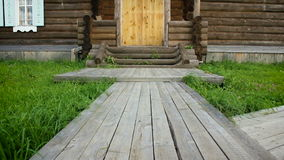 4 in 1: Two-storey wooden house, view of the front door, porch and veranda. HD.  stock footage