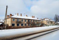 Two-storeyed barracks in the village of Karmanovo of Gagarinsky district. Smolensk region. Rural пейхаж in the winter stock images