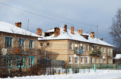Two-storeyed barracks in the village of Karmanovo of Gagarinsky district. Smolensk region. Rural пейхаж in the winter royalty free stock images