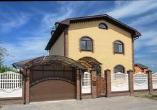 Two-storeyed yellow brick house Royalty Free Stock Image