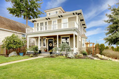 Two story american house with white column porch Stock Photos