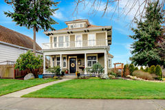 Two story american house with white column porch Stock Images