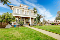 Two story american house with white column porch Royalty Free Stock Images