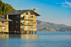 Two story apartment building on the water Royalty Free Stock Image