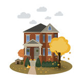 Two story autumn house. With falling leaves and decorated with pumpkins on isolated background Stock Image