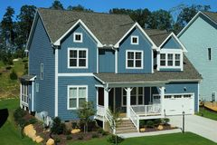 Two-story, blue, suburban home in a neighborhood in North Carolina stock photos