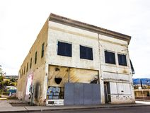 Two Story Commercial Building With Boarded Up Windows stock photography