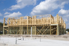 Two Story Construction. Two story frame condos under construction showing green wood on first floor and construction slab stock images
