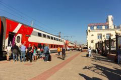 A two-story firm train from Moscow pulled up to the station in V royalty free stock photography