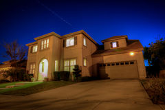 A two story home against a starry sky Stock Images